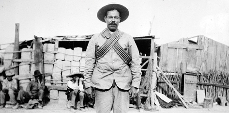 Mexican revolutionary General Pancho Villa, above in battle garb and bandoliers, dressed up for scenes in his 1914 semiautobiographical silent film. (Photo from Library of Congress)